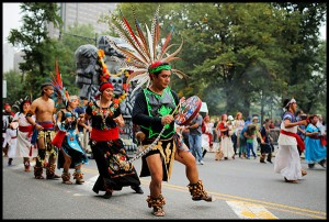 People dance during a rally against climate change in New York September 21, 2014.